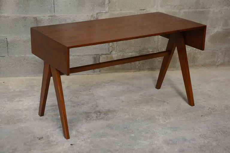 """Pierre Jeanneret, Student desk with V legs, solid teak and teak veneer. See photo before restoration when I bought it in Chandigarh.  Literature: Page 574 REF PJ-BU-08-C in: Eric Touchaleaume & G. Moreau """"Le Corbusier Pierre Jeanneret - The"""