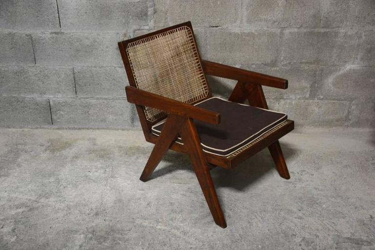Pierre Jeanneret cane and teakwood easy armchair from Administrative building in Chandigarh, India. See photo before restoration when I bought it in Chandigarh. REF 9. Literature: REF PJ-SI-29-A page 563 in: Eric Touchaleaume & G. Moreau