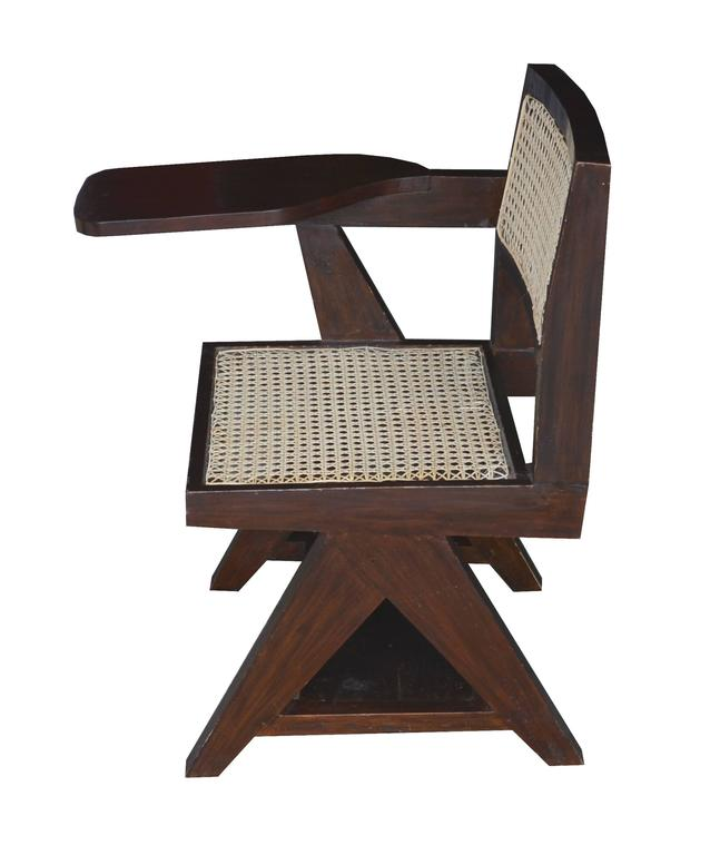 Pierre Jeanneret, teakwood writing cane chair from Punjab University in Chandigarh, India. See photo before restoration when I bought it in Chandigarh in 1999.
