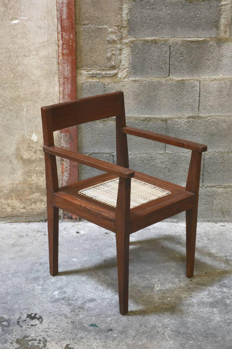 Pierre Jeanneret, very rare take down cane and teakwood armchair from Private Residence in Chandigarh, India. Rare original lettering on the back. Teak, woven cane and upholstered seat cushion featuring cloth covering. See photo before restoration