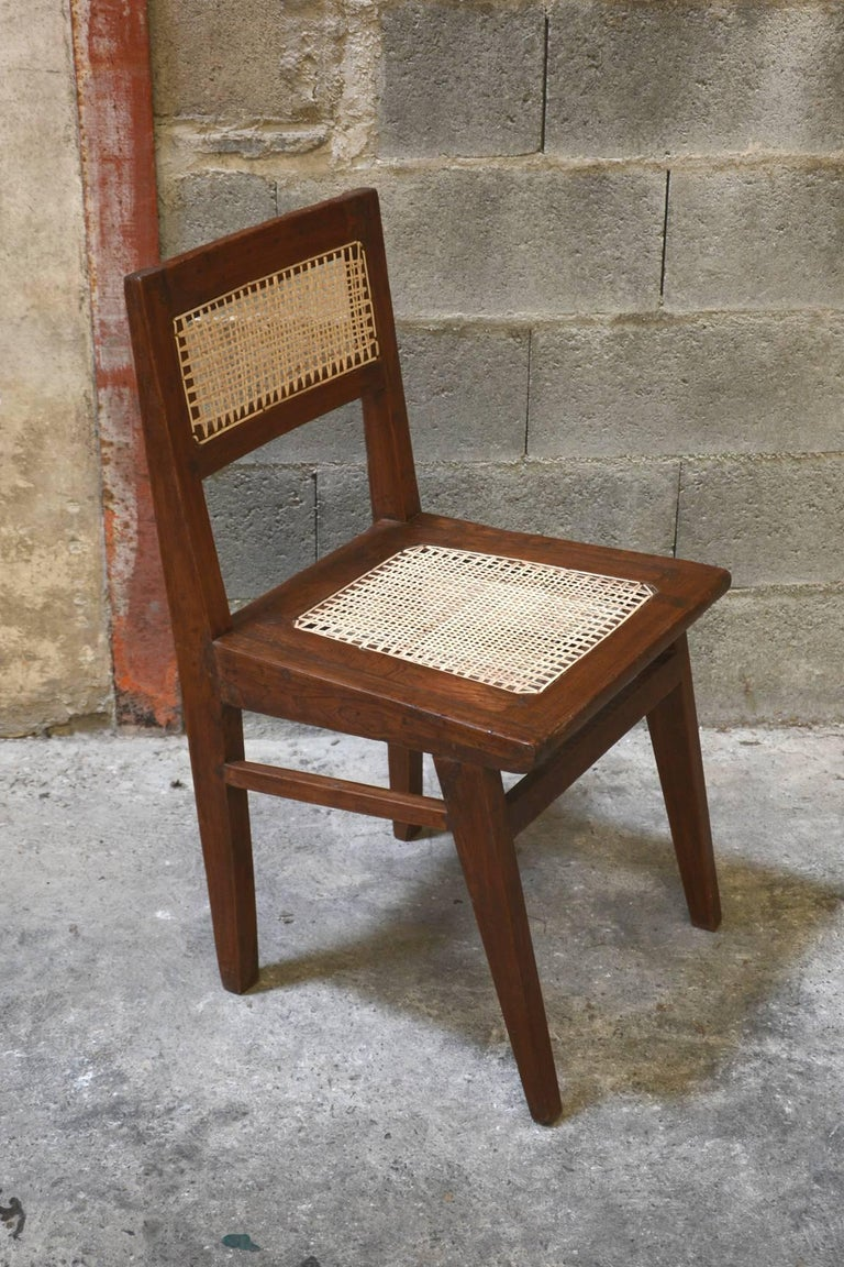 Pierre Jeanneret, very rare cane and teakwood chair from the Himalayan Hotel in Chandigarh, India. Version with lateral crossbar. Teak, woven cane and upholstered seat cushion featuring cloth covering.