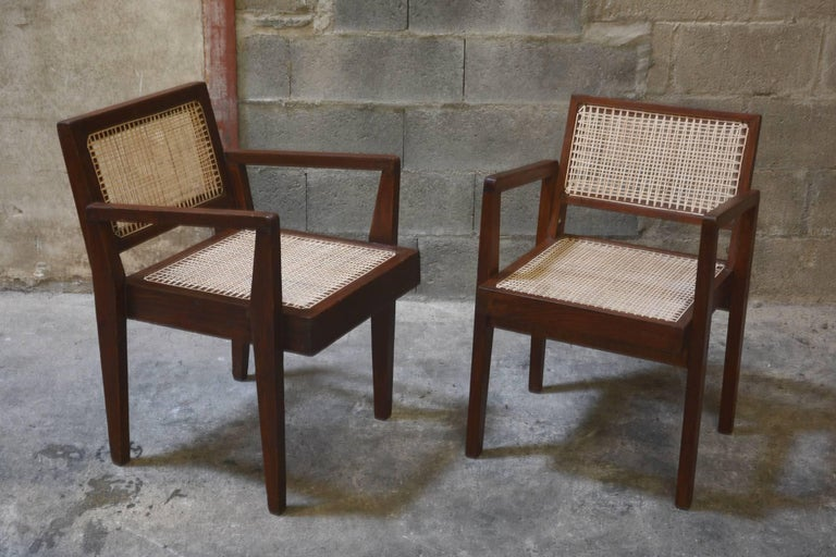 Pierre Jeanneret, very rare cane and teakwood pair of armchairs from Private Residence in Chandigarh, India. Rare original lettering on the back of each armchairs. Teak, woven cane and upholstered seat cushion featuring cloth covering. See photo