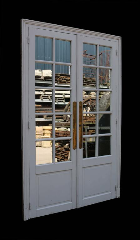 Sourced by US in France. These 19th century mirror doors have original glass and a painted finish. The door frames are oak with pine or walnut panels. Pine door frame.  Doors H 237.5 x W 139.5 x D 2.8 cm (93.5 x 54.9 x 1.10 in.)  (Please note that