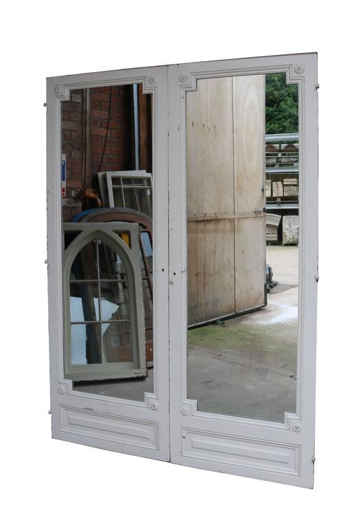 Pair of antique French double mirror doors. Original mirrors. These had previously been used as single doors. (Please note that the glass is not insured in transit outside of the UK).