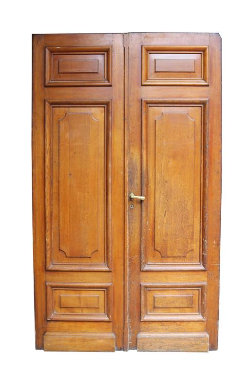 Pair of antique exterior oak double-door. With raised and fielded panels.