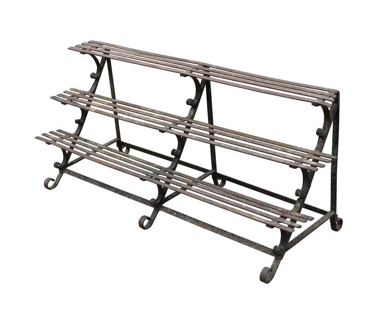 Three-tier wrought iron plant stand for a conservatory, orangery etc.