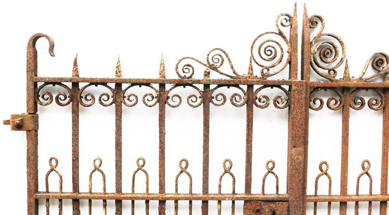 These gates are in sound condition with a rust finish. There is part of the original hinge present, however there is no latch and the lock does not work.  Width 174cm (excluding hinge).