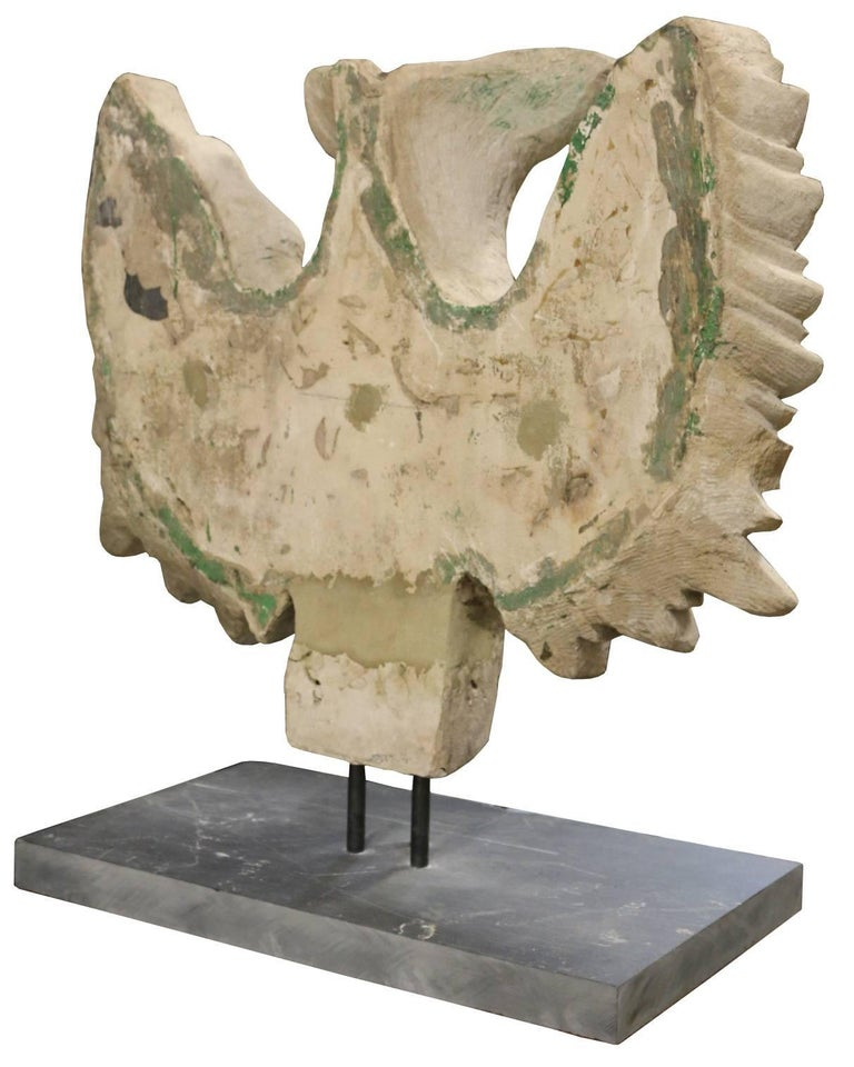 This eagle sculpture is made from Portland limestone and includes a slate base which is measure: 60 cm x 35 cm.  The eagle is decorated with crests.