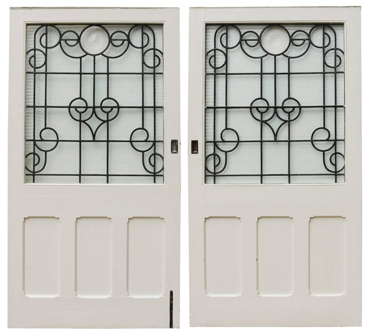 These doors have previously been sliding and the glass is a mixture of leaded, textures and roundels. Measures: Width 213 cm and 212.5 cm Weight 100 kg (total).