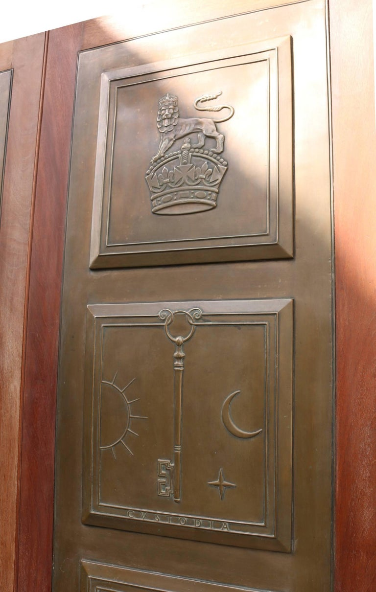 These doors are inset with bronze panels on the front and the back has four panels. Symbol meanings below: George and the Dragon- The most famous legend of Saint George is of him slaying a dragon. In the middle Ages the dragon was commonly used to