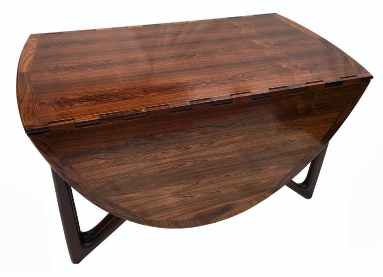 Oval rosewood drop flap dining table by kurt ostervig for for Table exit fly