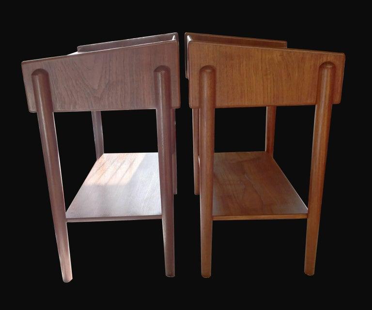 A cool pair of Scandinavian Modern, midcentury teak single drawer side tables with undershelf designed by Børge Mogensen for Søborg Mobelfabrik in the early 1960s.