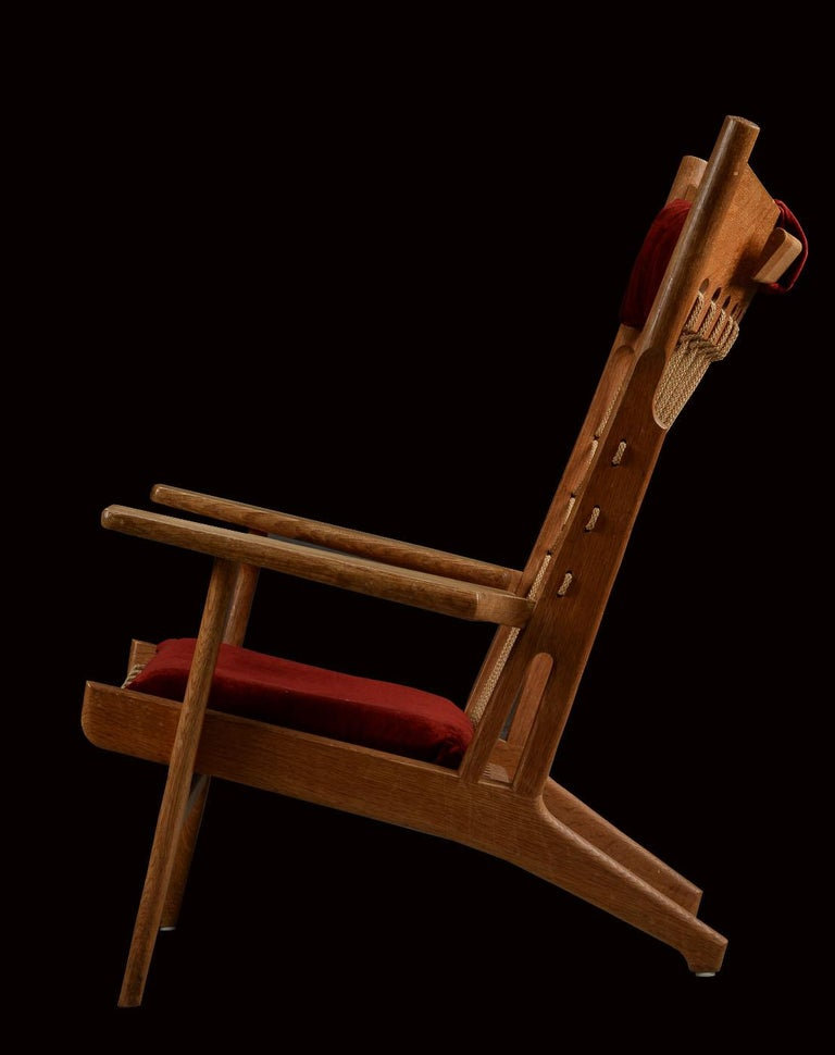 This chair is in museum condition, untouched from the day it was made! It is a very rare chair anyway, but in this condition. Beautiful patina and with what appears to be, original red velvet covers, all halyard (Ropework) original and undamaged, it