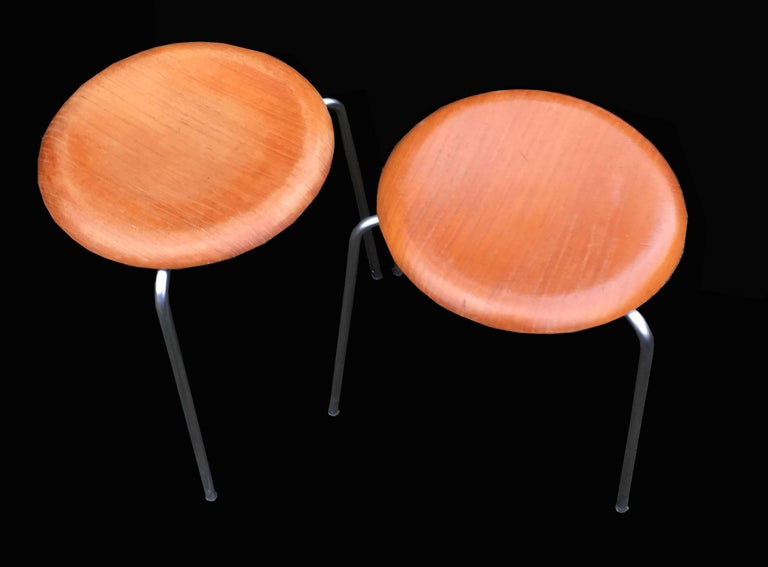 Very nice three-legged teak top pair of cool stools by Arne Jacobsen for Fritz Hansen.Just 2 left