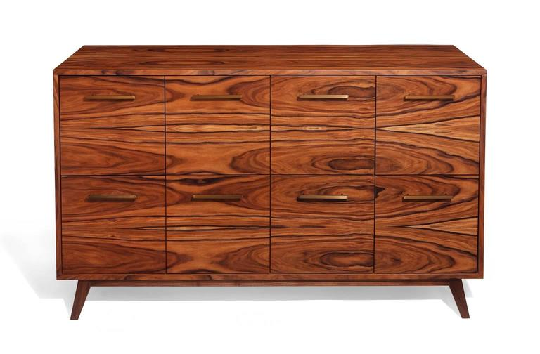 TheAtocha Design record cabinet is a handcrafted furniture piece that gives you quick access to your music collection—and elegant storage when it's not in use.  The featured piece uses Santos Palisander hardwood veneer, a sustainable species