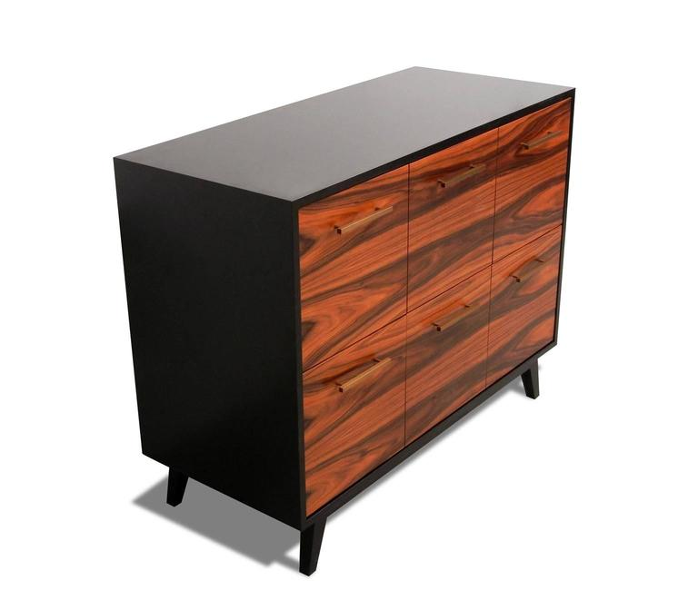 The Atocha Design Record cabinet is a handcrafted furniture piece that gives you quick access to your music collection—and elegant storage when it's not in use.  The featured piece uses santos palisander hardwood veneer, a sustainable species