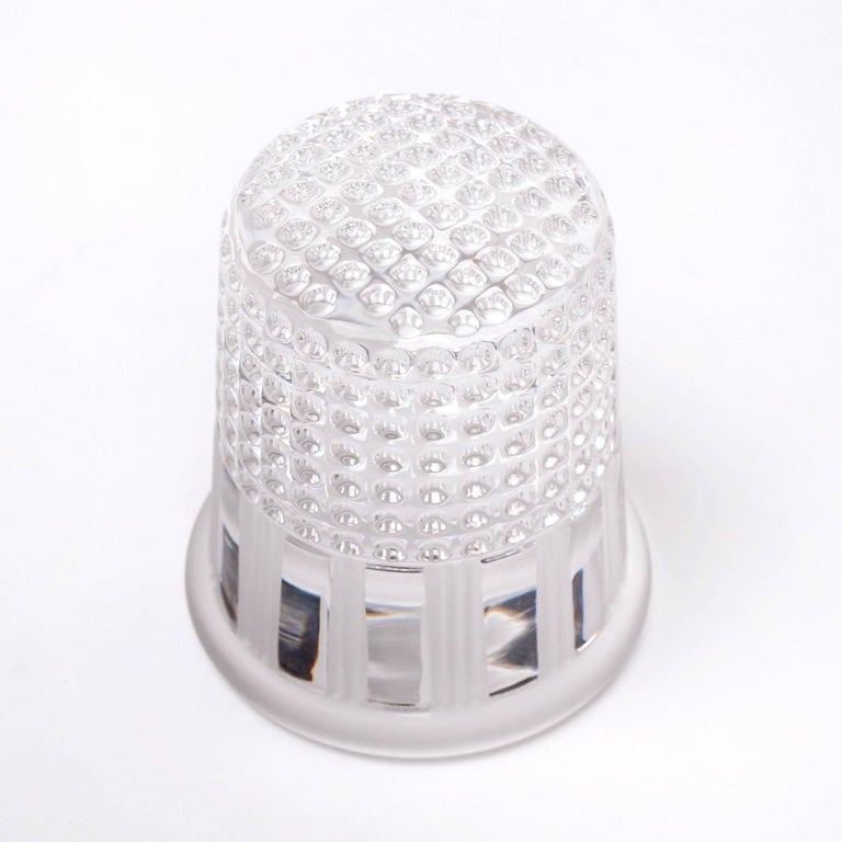 A 1970s paperweight by Christian Dior for French crystal glass manufacture, Crystal Au Plomb. The paperweight features a glossy perforated surface towards the top, imitating that of a thimble, with an alternating frosted scalloped design surrounding
