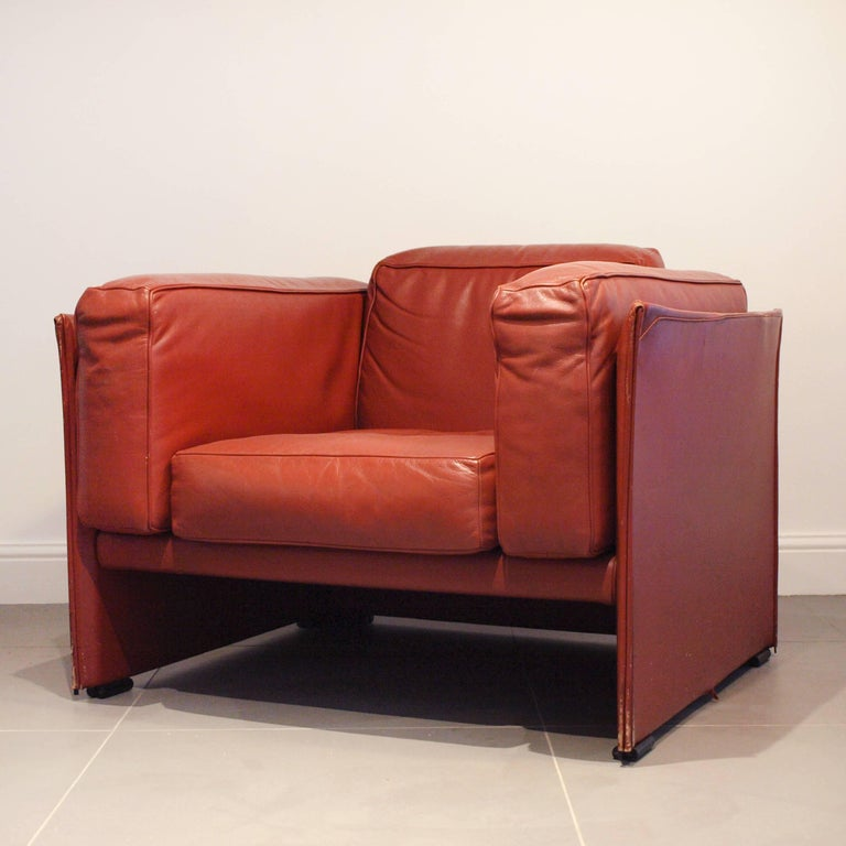 A Red Leather Cina 405 Duc Armchair On Chrome Feet Designed By Mario Bellini