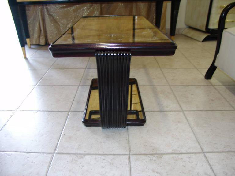1940s coffee table attributed to Osvaldo Borsani. It is made of lacquered walnut wood, the glass are sandblasted and the mirror is original.