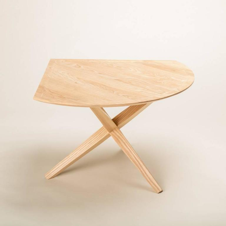 """This bleached ash version our walnut table has a grain pattern not unlike long hair floating underwater. Our signature """"jack base"""