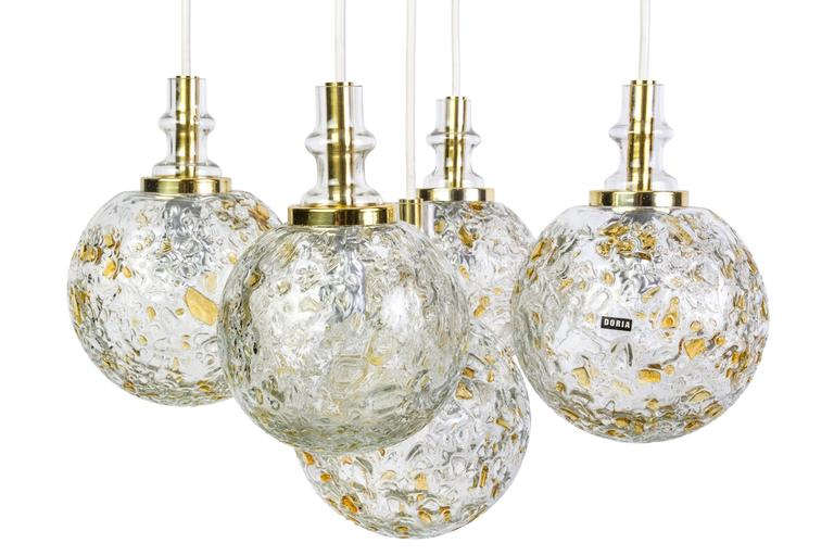 This superb ceiling pendant by Doria features five cascading Murano glass balls in excellent original condition. The beautiful corrugated blown glass shades provide the perfect filtered light and disguise for the bulbs.  Measures: Diameter glass