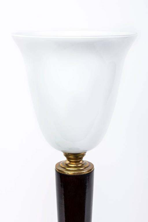 This wonderful 1930s French Art Deco tabletop lamp by Mazda features a wood base with brass detailing with a pearl opaline glass shade. It has been newly rewired and is in excellent condition.