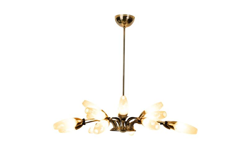 This spectacular 1950s Sputnik spider chandelier features a 16-arms brass frame with leafs and rings details in black enamel and a floral motif glass shades in enamel pearl color. The piece cascades in two levels.  Made in Austria, circa