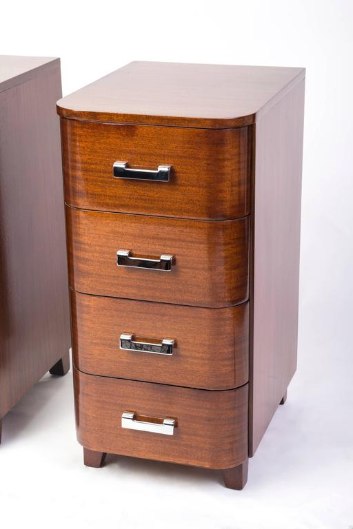Pair of tall Art Deco streamline nightstands with four drawers in solid mahogany and nickel-plated metal hardware.