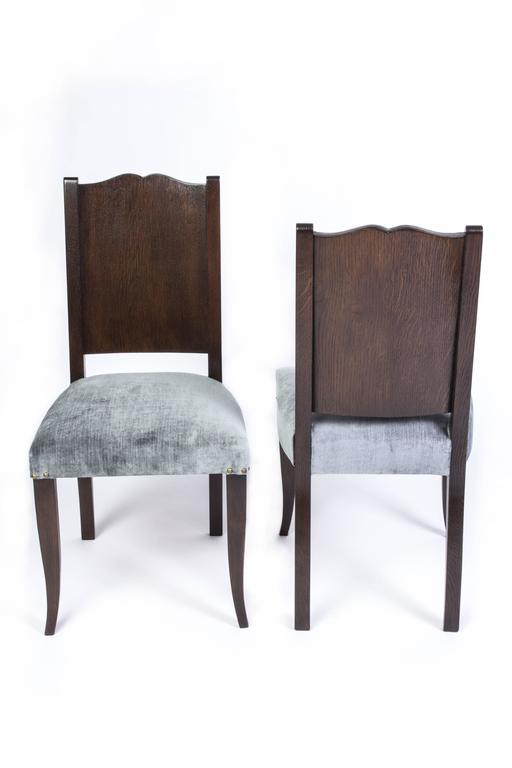 Stunning set of eight (8) French Art Deco dining chairs in stained Tiger Oak by Alfred Porteneuve.