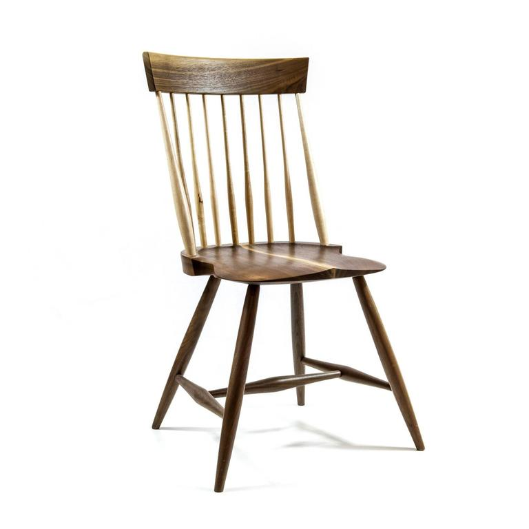 Walnut version of a simplified traditional American chair with maple back slats. A minimal take on the classic. Available as a side chair or a captain's chair. Handmade in Pennsylvania.  Designed by our sister brand Shimna.