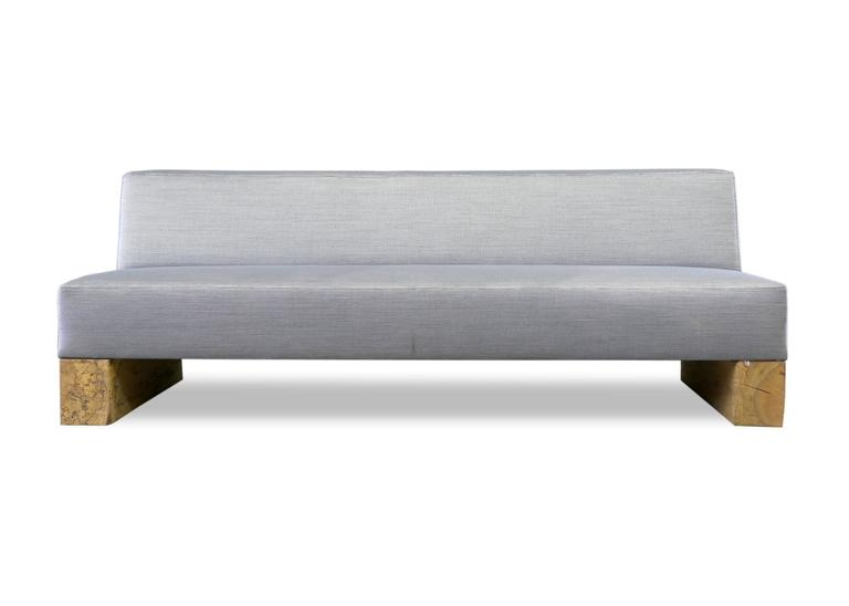 A Short Armless Version Of The Beam Sofa Upholstered In Woven Steel Blue