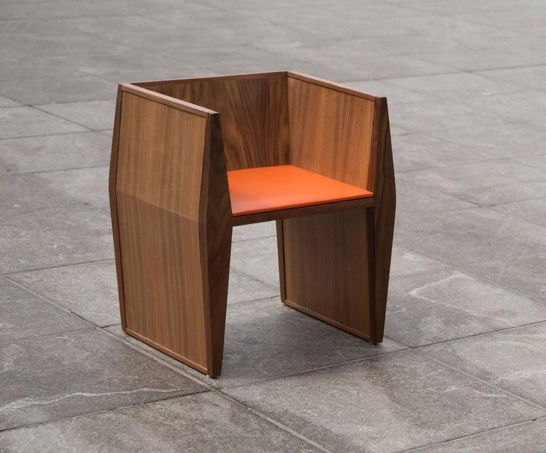 This angular chair has two diamond shaped vertical supports joined by a clean horizontal seat and an angled backrest. Even though the chair is comprised entirely from geometric shapes, it has a sense of character and rhythm and is as much an elegant