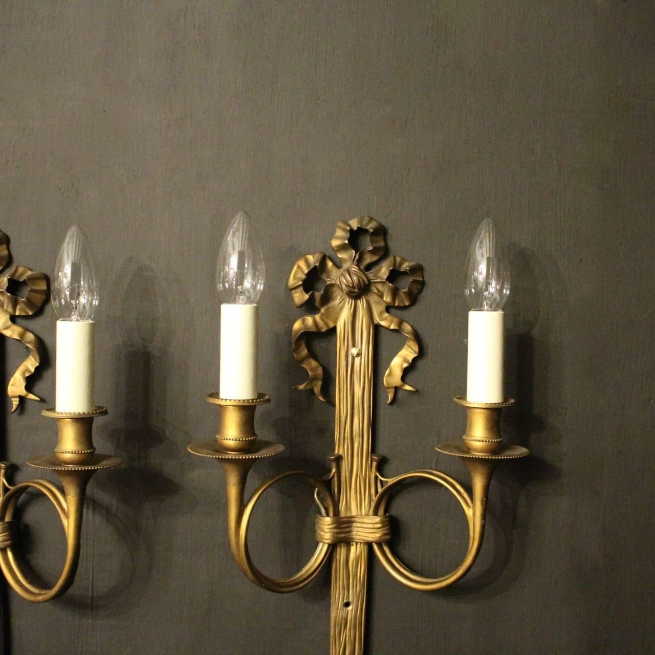 A French Pair Of Gilded Bronze Twin Arm Ribbon Antique Wall Sconces, The  Scrolling Arms