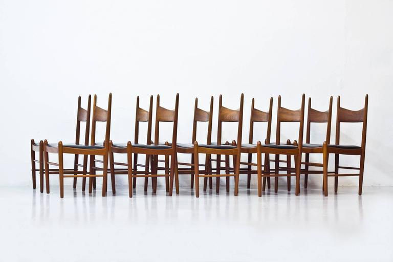Rare set of ten chairs designed by Illum Wikkelsø. Produced in Denmark by Vestervig Eriksen and Brøderna Tromborg Møbelfabrik during the 1950s. Solid teak frame with black leather seats. Excellent vintage condition, with very few signs of wear and
