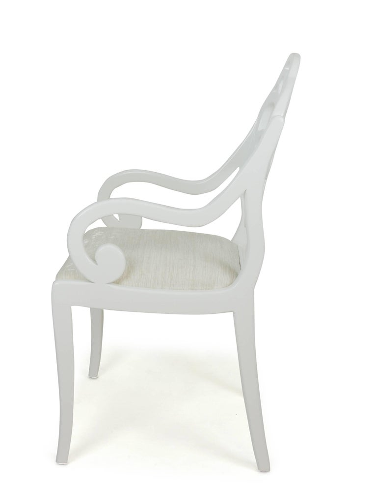 With arms resembling English Regency and a back inspired by an Albert Hadley design, these dining chairs are designed by Jhon Ortiz and produced at his company workroom in Norwalk, CT. The chairs feature a sabre leg and are shown with a fine