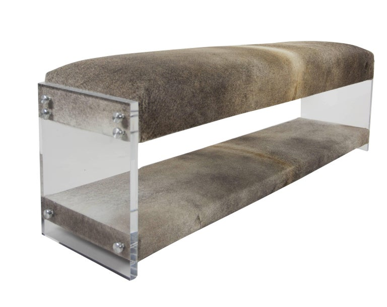 The sophisticated Hide and Sleek Bench is made of Lucite and cowhide and offers comfortable seating while also being low-profile. Made in our Norwalk, CT workroom.  Measurements: 19