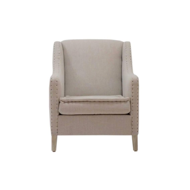 The Aspetuck club chair features exposed nailheads, the