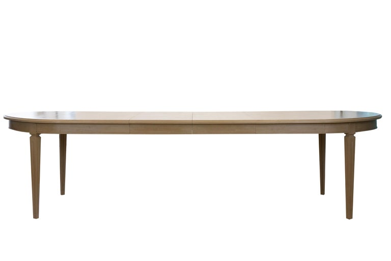 Our Yvelines dining table is made out of white oak and finished in a custom paint treatment. Includes 2 18