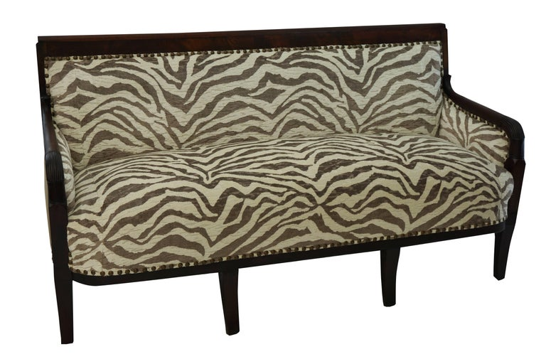 Mahogany frame Empire Settee, circa 1870.  Newly upholstered in taupe and crème zebra velvet, with nail heads.