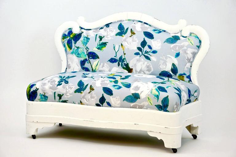 Petit Victorian Settee with white painted frame. Newly upholstered in Romo cotton floral fabric. Beautiful cottage settee.
