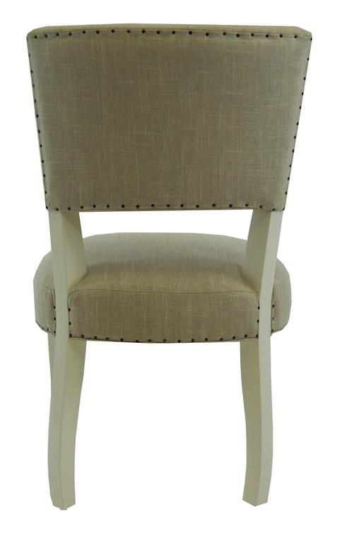 Transitional dining chair with a toned down cabriole leg. A design staple. Comes standard with smoke colored linen and antiqued grey finish.  Choice of three linen colors standard at this price. COM available at same price.  Dimensions Outside