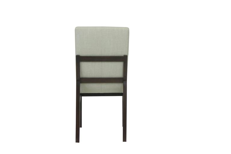 The principal feature of this dining chair is its reclined shape. Typically, dining chairs are meant to keep us upright and in