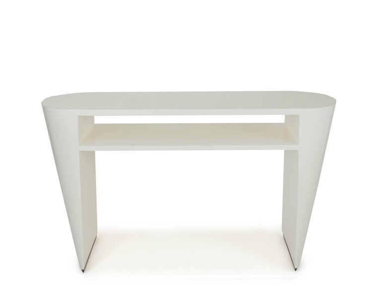 Our new Art Deco inspired lacquered console table.  Made with maple wood lacquered in White Dove. Tapered, rounded wedge legs Named