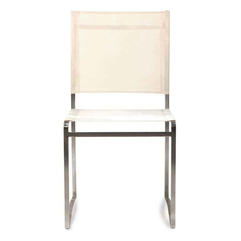 white flexy outdoor dining side chair by royal botania