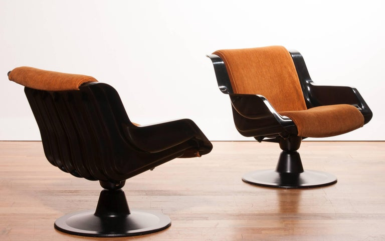 Very nice and rare chairs designed by Yrjö Kukkapuro for Haimi, Finland. The chairs is made of a black fiberglass frame on an aluminium rotation base and a cognac brown fabric upholstery with screw fastening. They are in a beautiful condition and