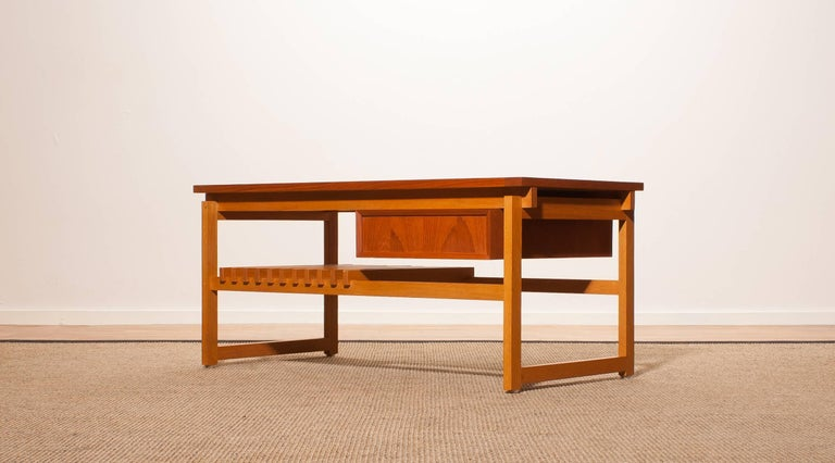 Beautiful coffee table made in Denmark . This side table is made of teak and has a drawer and a magazine rack . It is in a very nice condition. Period 1950s Dimensions : H.45 cm , W.100 cm , D.48 cm.