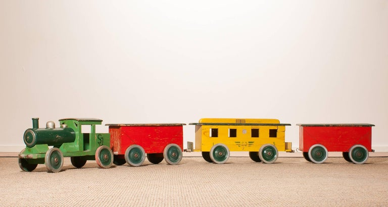 Very adoring large wooden toy train.