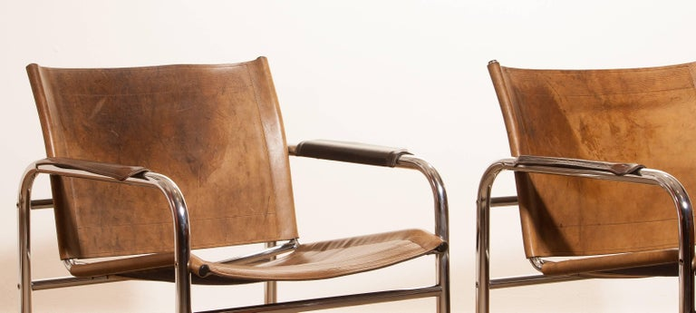 1960s , A pair of Leather and Tubular Steel ArmChairs 'Klinte' by Tord Björklund 9