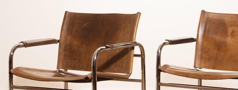 1960s , A pair of Leather and Tubular Steel ArmChairs 'Klinte' by Tord Björklund 7