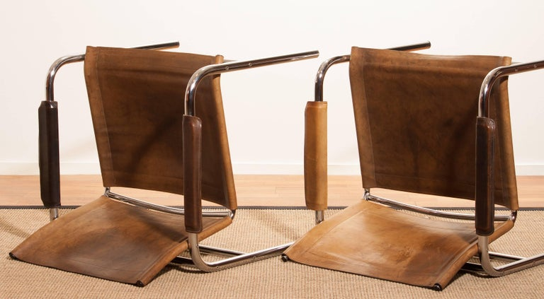 1960s , A pair of Leather and Tubular Steel ArmChairs 'Klinte' by Tord Björklund 10
